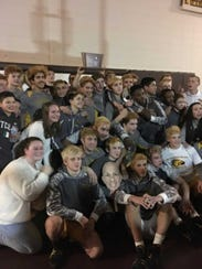 The Watchung Hills wrestling team poses after winning