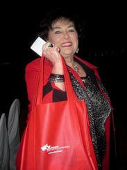 "Sandra Braddock, one of the ladies in red, at the ""Go"