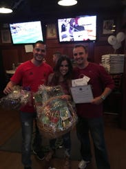 From left, Tricky Tray winners Victor Troca and Aly