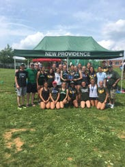 The New Providence girls track team pose after winning