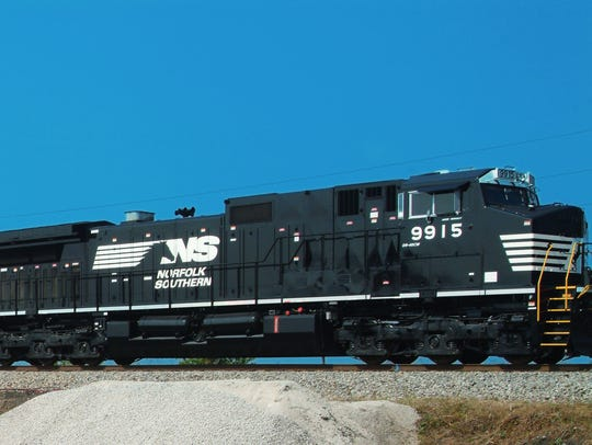 A Norfolk Southern double-stacked train makes its way