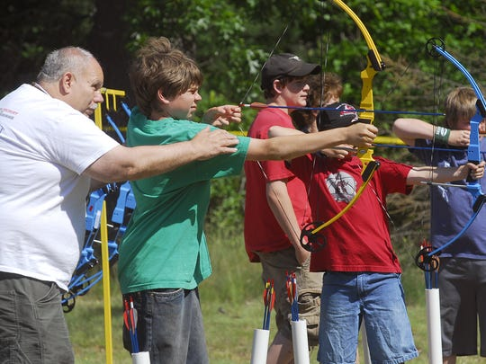 Archery at the Kiwanis Youth Outdoors Day at Lake Wazeecha, 2007.
