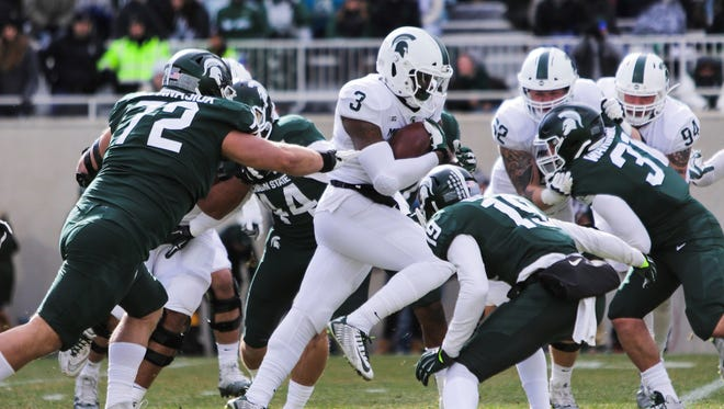 Michigan State running back LJ Scott looks for yards during the Spartans' Green-White spring football game, Saturday, April 7, 2018.