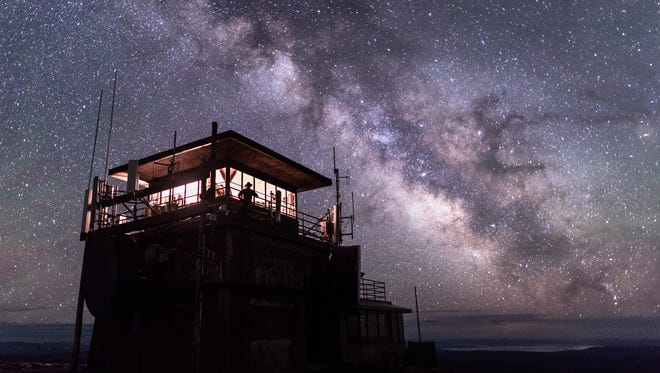 Washburn Fire Lookout under the Milky Way in Yellowstone National Park, which is celebrated for its dark skies and starry nights.