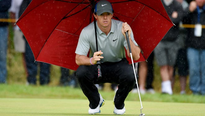Rory McIlroy under an umbrella on the 4th green during his third round at The Open Championship at the Royal Liverpool Golf Club.  Rain may be a factor at the PGA Championship and new technology could help make the play easier.