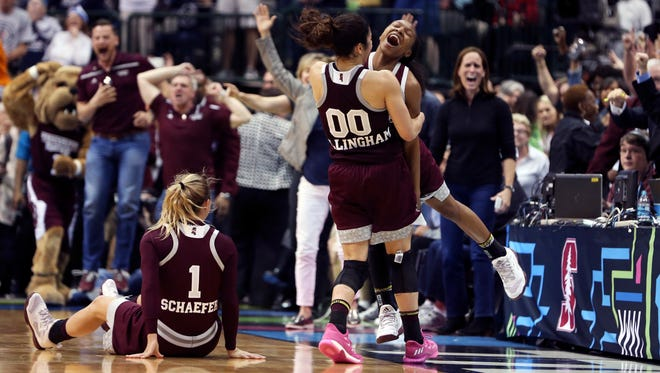 Mississippi State players celebrate after beating Connecticut at the women's Final Four.
