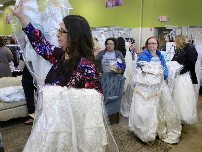 Brides gather dress deals at Wauwatosa Goodwill