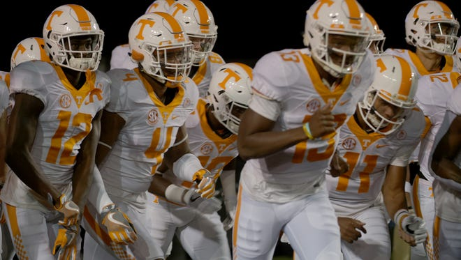 The Vols enter the field before the game between Vanderbilt and Tennessee at Vanderbilt Stadium on Saturday in Nashville.