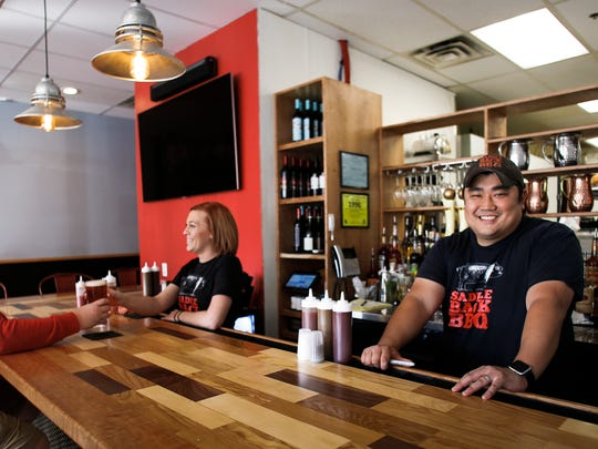 Matt Gillett, right, owner of Saddleback BBQ has opened