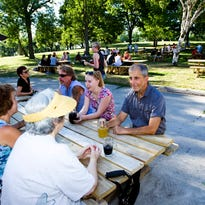 The Garvey family sits and enjoys beer outside at the Humboldt Park Beer Garden in 2015.