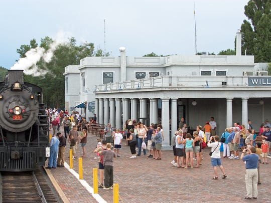 Grand Canyon Railway passengers gather at the Williams Depot, preparing to board for a ride to the South Rim.
