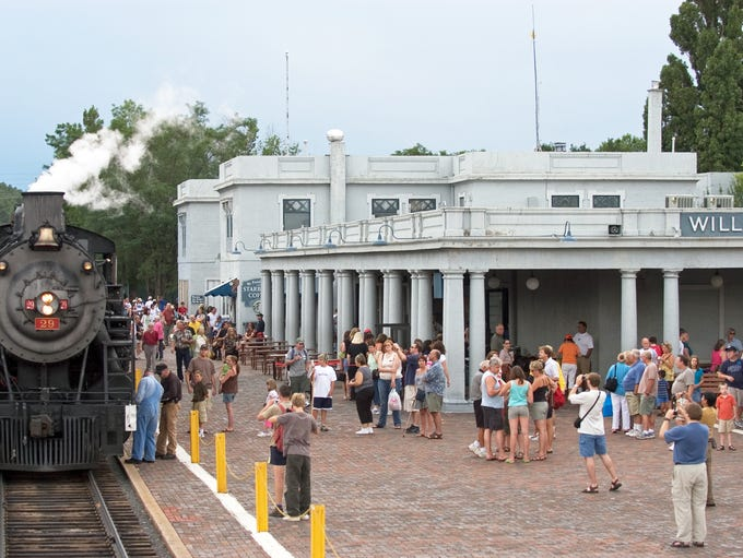 Grand Canyon Railway passengers gather at the Williams