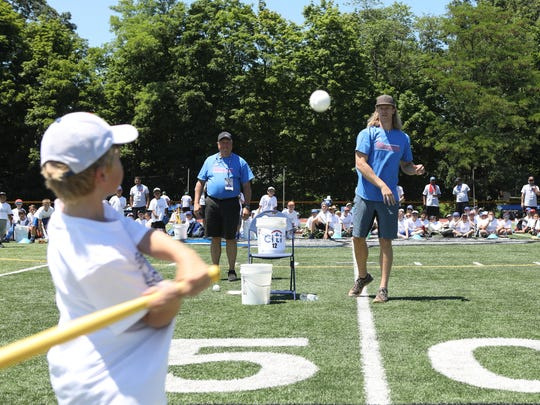 Noah Syndergaard pitches a wiffle ball to a young baseball player in Wayne.  The Citi Noah Syndergaard Baseball Camp took place at Passaic County Technical Institute in Wayne, Thursday, July 19, 2018.