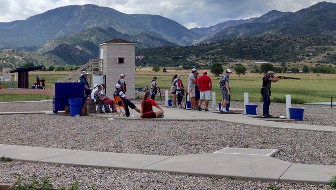 Brooklyn's Elizabeth Worthington, far right, takes aim during the 2016 Junior Olympic Development Camp held at the Olympic Shooting Center, Colorado Springs, Colo.
