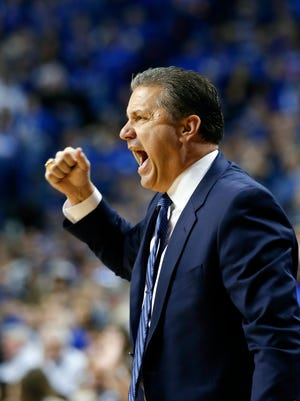 Kentucky's John Calipari yells at his team on the court.   Jan. 12, 2015