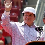 Pete Rose waves to the crowd during a ceremony to retire his No. 14 with the Cincinnati Reds.