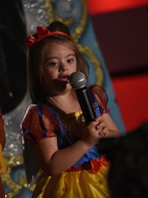"""Adiyah Blanchard dresses up as Snow White as she performs with others in the show """"Dreams"""" presented by The Arc Showstoppers at the Arc Multipurpose Center Sunday afternoon."""