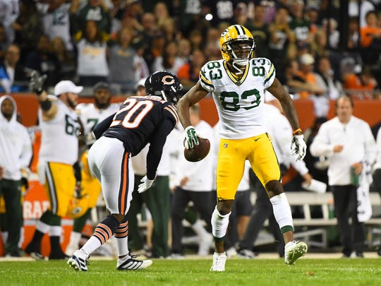 Sep 5, 2019; Chicago, IL, USA; Green Bay Packers wide receiver Marquez Valdes-Scantling (83) reacts after making a catch in front of Chicago Bears cornerback Prince Amukamara (20) during the second quarter at Soldier Field. Mandatory Credit: Mike DiNovo-USA TODAY Sports