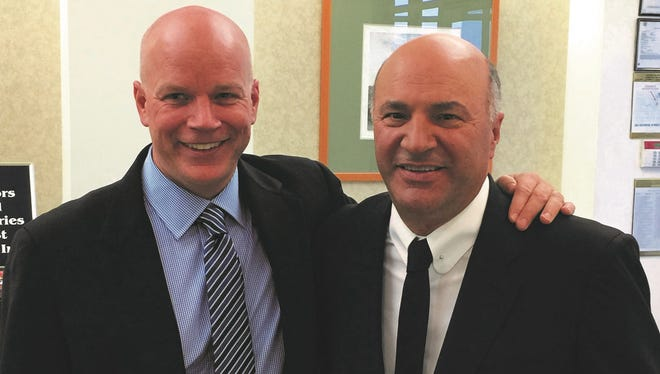 """Andrew McMurray, left, national wine consultant of Zipz Packaging Technologies, is pictured with """"Shark Tank"""" investor Kevin O'Leary at Zipz's New Brunswick headquarters. O'Leary has helped open doors for Zipz with retailers, airlines and hotels."""
