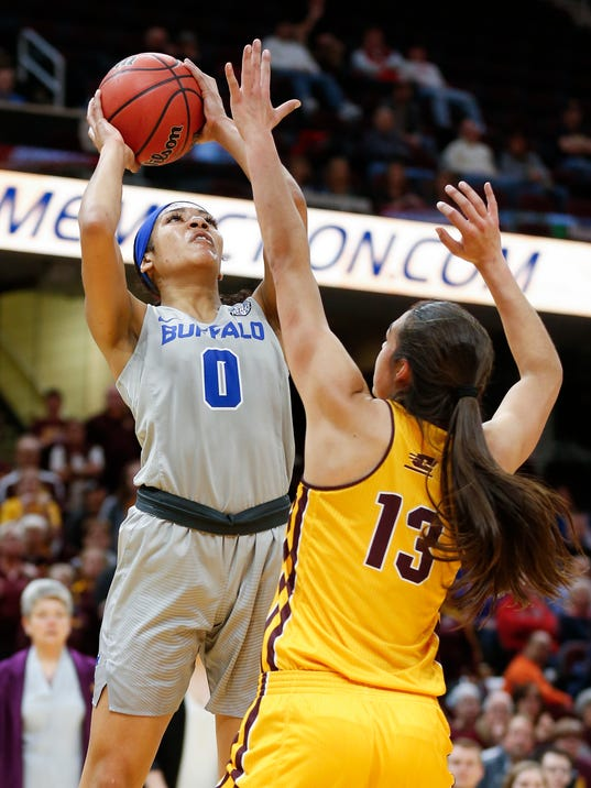 Buffalo forward Summer Hemphill,left, shoots over Central Michigan forward Reyna Frost during the first half of an NCAA college basketball game in the championship of the Mid-American Conference tournament Saturday, March 10, 2018, in Cleveland. Central Michigan won 96-91. (AP Photo/Ron Schwane)