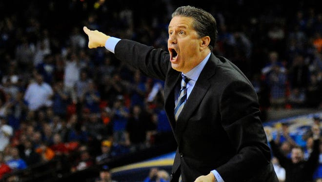 Kentucky Wildcats head coach John Calipari reacts to a play against the LSU Tigers during the first half in the quarterfinals of the SEC college basketball tournament at Georgia Dome.
