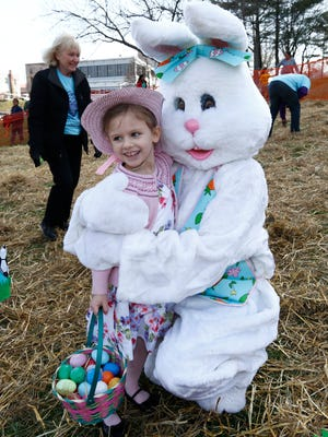 Harriet Luongo, 5, from Poughkeepsie gives the Easter Bunny a hug after collecting her eggs at the annual John Flowers Easter Egg Hunt at Waryas Park in Poughkeepsie on Saturday, April 15, 2017.