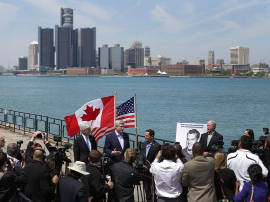 Michigan Governor Rick Snyder, from left Canada Prime Minister Stephen Harper and Murray Howe, Gordie Howe's son, announced that the future publicly owned bridge between Windsor, Ontario and Detroit, Michigan would be named Gordie Howe international bridge during a press conference in Windsor, Canada on Thursday, May 14, 2015.