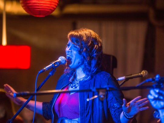 Caryl Lawson of The Wishbone Tribute Band sings in