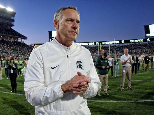 Michigan State Spartans head coach Mark Dantonio celebrates a win over the Iowa Hawkeyes after a game Sept. 30, 2017, at Spartan Stadium.