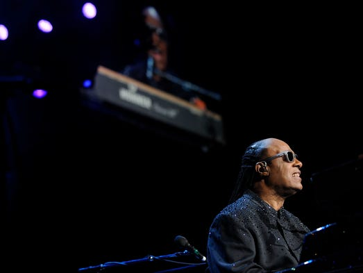 A large screen projects Stevie Wonder's image during
