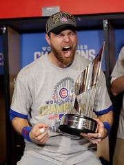 Chicago Cubs' Ben Zobrist celebrates with his MVP trophy after Game 7 of the Major League Baseball World Series against the Cleveland Indians on Thursday, Nov. 3, 2016, in Cleveland. The Cubs won 8-7 in 10 innings to win the series 4-3. (AP Photo/David J. Phillip)