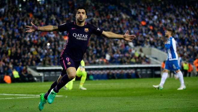 FC Barcelona's Luis Suarez reacts after scoring against Espanyol.