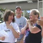 Kay Hoagland, left, reacts as she is surprised by Builders Care at her Fort Myers home on Thursday. Her son Howard and daughter Kathy are all smile as they see their mother's reaction to receiving a new roof for her home.