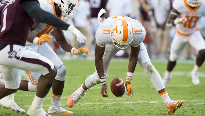 Tennessee quarterback Joshua Dobbs (11) tries to recover a ball fumbled by Tennessee running back John Kelly (4) during the second half of the game against Texas A&M on Saturday, October 8, 2016. Tennessee loses to Texas A&M, 38-45. (SAUL YOUNG/NEWS SENTINEL)
