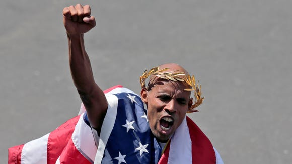 In this April 21, 2014 file photo, Meb Keflezighi celebrates his victory in the 118th Boston Marathon. (AP Photo/Charles Krupa, File)