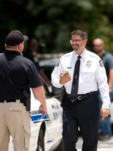 Stuart Police Chief David Dyess talks with his officers
