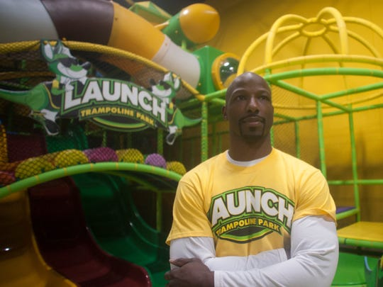 Jason Avant shows off a multilevel kids' playground