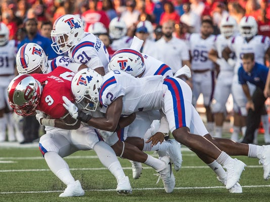 FILE - In this Sept. 16, 2017, file photo, Western Kentucky wide receiver Xavier Lane (9) is tackled by a group of Louisiana Tech players during an NCAA college football game in Bowling Green, Ky. Louisiana Tech takes on SMU in the Frisco Bowl on Dec. 20. (Austin Anthony/Daily News via AP, File)