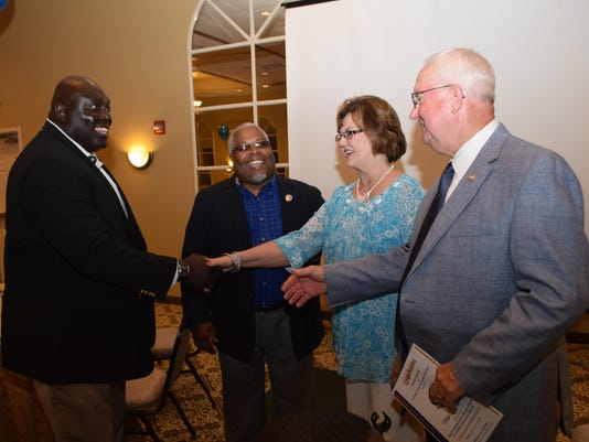 ANI Meet the Jaguars Myron Lawson (second from left), a board member of Southern University, introduces Dawson Odums (far left), head football coach at Southern University, to Sheriff William Earl Hilton (far right) and his wife Billie Faye Hilton at South