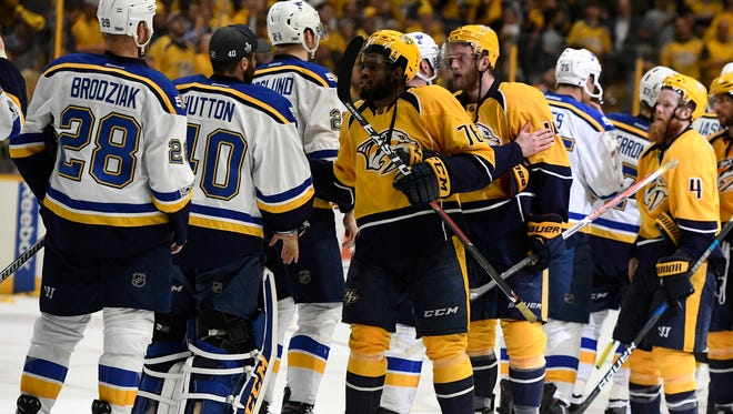 Predators defenseman P.K. Subban (76) and his teammates shake hands after beating the Blues in the second round Sunday, May 7, 2017.