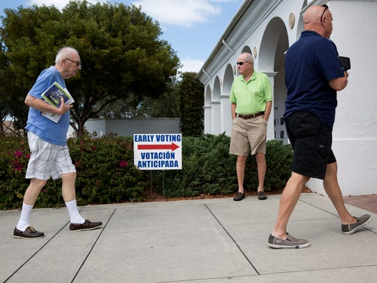 Voters make their way into the Collier County Public Library for early voting at the polls Wednesday, March 9, 2016, in Naples.