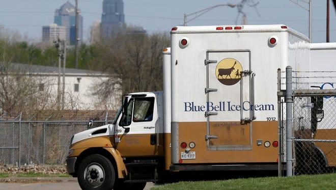 FILE -In this April 10, 2015 file photo, Blue Bell delivery trucks are parked at the creamery's location in Kansas City, Kansas. Blue Bell ice cream had evidence of listeria bacteria in its Oklahoma manufacturing plant as far back as March 2013, a government investigation released Thursday says. The company then continued to ship ice cream produced in that plant after what the Food and Drug Administration says was inadequate cleaning. (AP Photo/Orlin Wagner, File)