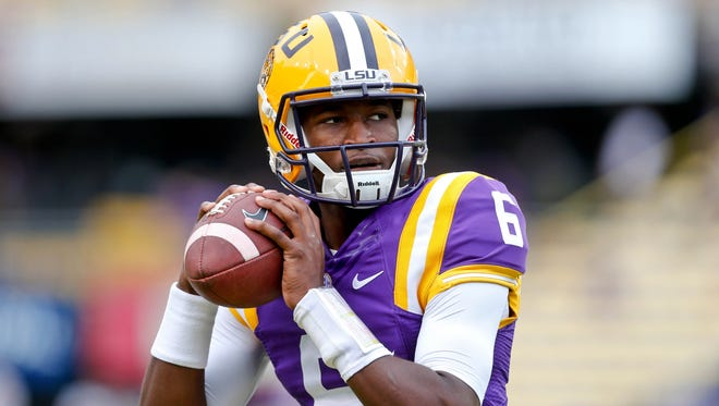 LSU quarterback Brandon Harris warms up.