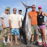 Katie Bankers with a 214 pound bigeye tuna caught aboard the Canyon Dreams II with Capt. Jim Gray.