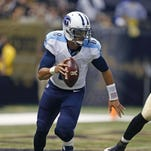 Tennessee Titans quarterback Marcus Mariota (8) scrambles in the first half of an NFL football game against the New Orleans Saints in New Orleans, Sunday, Nov. 8, 2015. (AP Photo/Butch Dill)