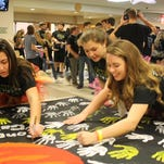 Students learn the Morale Dance during the 6th annual Floyd Central Dance Marathon benefitting Riley Children's Hospital at Floyd Central High School in Floyds Knobs on Saturday.