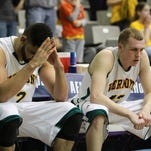 Seniors Luke Apfeld (left) and Sandro Carissimo (right) are shocked during the final seconds of their loss to Albany in the America East Conference Semifinal at SEFCU Arena in Albany, NY on March 9, 2014.
