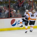 Center Vincent Lecavalier (left) celebrates his game- winning overtime goal Sunday with defenseman Kimmo Timonen as the Flyers defeated the Capitals, 5-4.