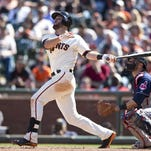 Brandon Hicks hits a walk-off three-run home run against the Cleveland Indians during the ninth inning at AT&T Park on Sunday. The San Francisco Giants defeated the Cleveland Indians 4-1.