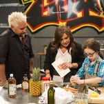 "Host Rachael Ray advises contestant Finn Skerlj  on his dish as seen on Food Network's ""Rachael vs. Guy: Kids Cook-Off,"" Season 2."